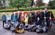 Litter lifters posed in front of skip